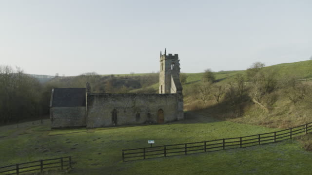 descending shot of the ruined st martins church of wharram percy - ornate stock videos & royalty-free footage