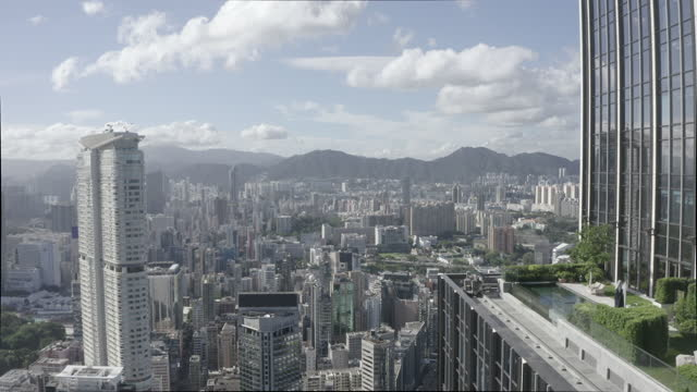 description ungraded 10 bit dlog-m aerial footage of the hong kong city skyline - log stock videos & royalty-free footage
