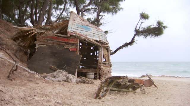 ms desert island shelter on wild beach on overcast morning / inhambane, mozambique - hut stock videos & royalty-free footage
