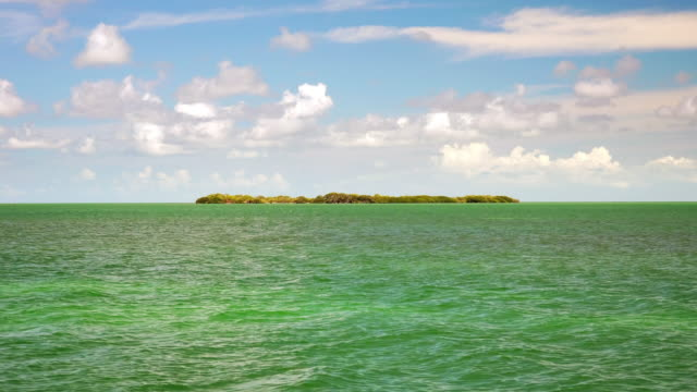 desert island surrounded by tropical ocean in the florida keys, timelapse - desert island stock videos & royalty-free footage