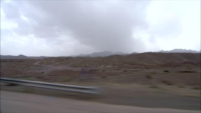 WS SIDE POV Desert landscape, Iran
