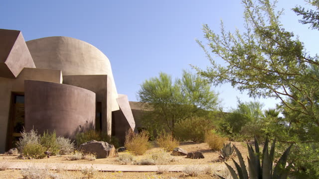 ws pan desert landscaped garden to front entrance of palm desert henderson community center / palm desert, california, usa  - community centre stock videos & royalty-free footage