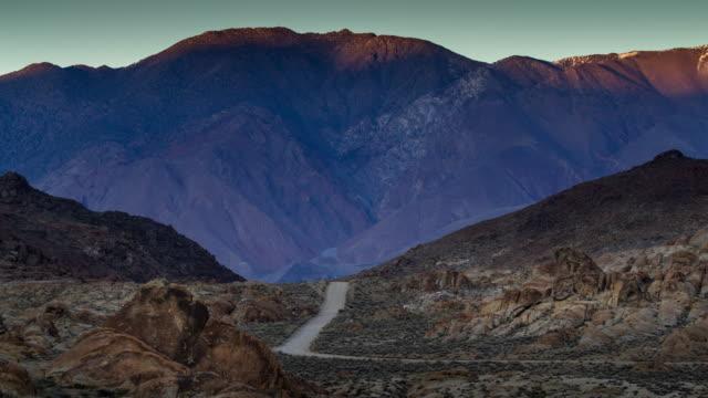Desert Mountain Road falling into Shadow - Time Lapse