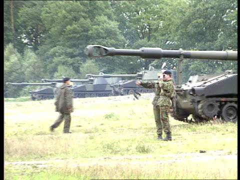 desert rats preparation in bergen hohne west germany bergen hohne tanks positioned / gun fired / nearby soldiers stack shells / shell explosion... - drill instructor stock videos & royalty-free footage