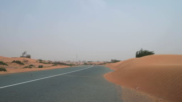desert road covered with sand during a sand storm in the uae - tarmac stock videos & royalty-free footage