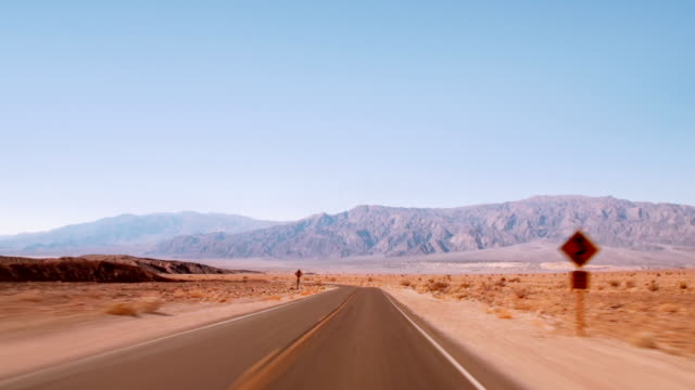 desert road. time lapse - death valley national park stock videos & royalty-free footage
