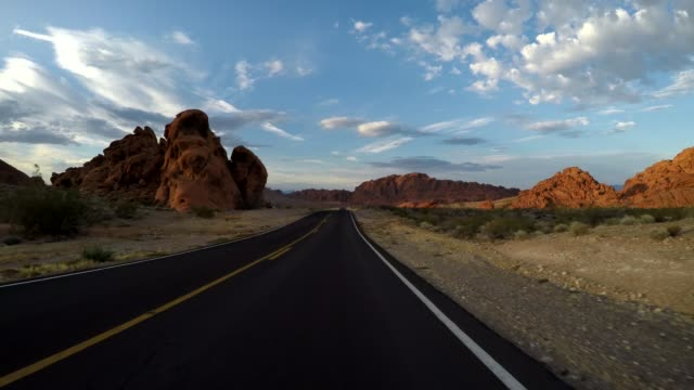 vidéos et rushes de desert road views in nevada during evening usa nevada various of point of view of driver as car driven along roads through the nevada desert - nevada