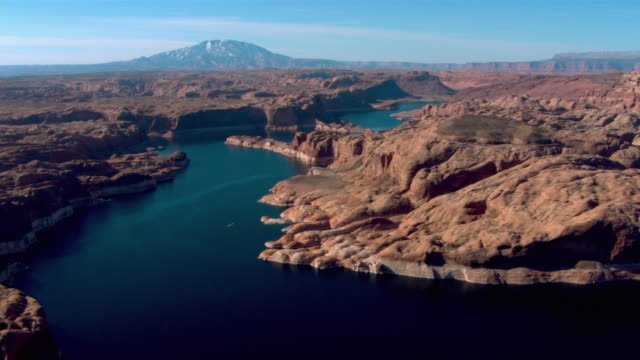 desert rock formations surround lake powell in glen canyon national recreation area. - lake powell stock videos & royalty-free footage