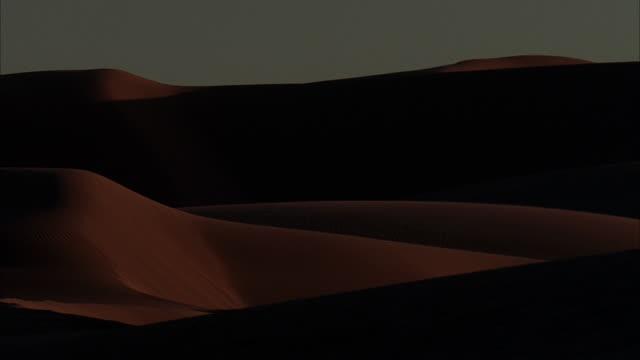 ws, desert sand dunes at dusk / california - palm springs california stock videos & royalty-free footage
