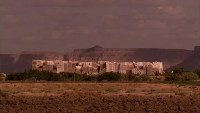 Desert terrain borders the town of Shibam Yemen.