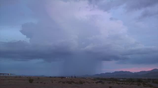 Desert thunderstorm over Tucson Arizona with very bright bolt of forked lightning, dusk, Arizona Monsoon, Arizona, USA.