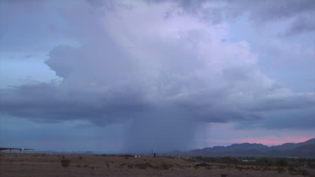 desert thunderstorm with very bright bolt of forked lightning, dusk, arizona monsoon, arizona, usa - forked lightning stock videos and b-roll footage