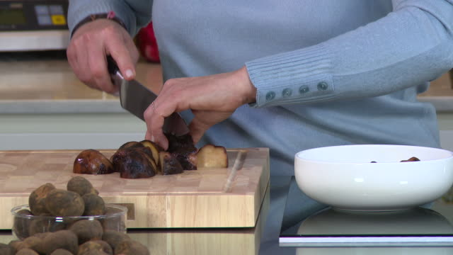 desert truffles view of a cook chopping cooked terfeziaceae or desert truffles known in the arab world as kamaa - chopping stock videos & royalty-free footage
