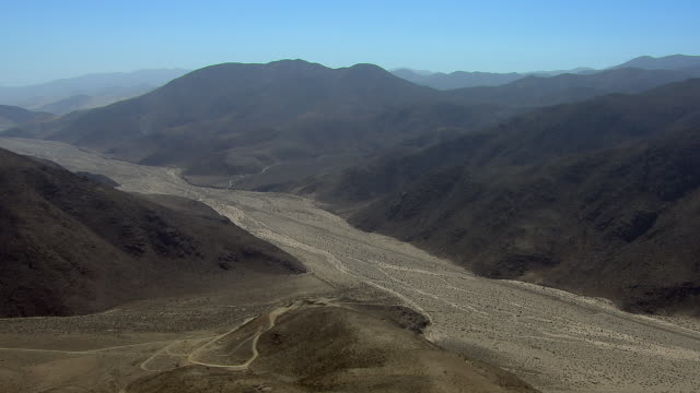 Desert Wash And Mountains In Chile