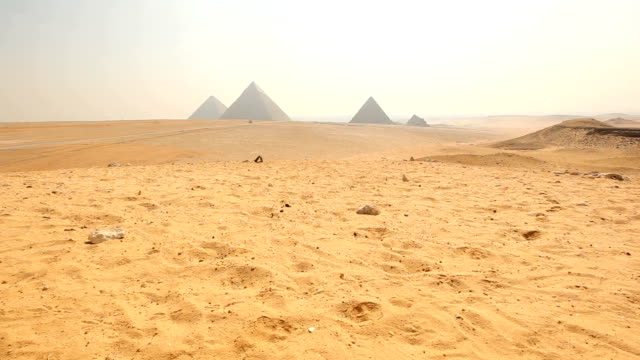 ES Desert with Giza pyramidsl in the distance/ Cairo / Egypt