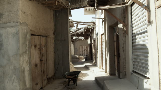 ws deserted alley in market with closed shops, bahla, oman - shutter stock videos and b-roll footage