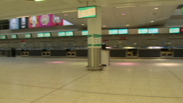 deserted check in area at glasgow airport due to coronavirus pandemic and changing quarantine rules - aerospace stock videos & royalty-free footage