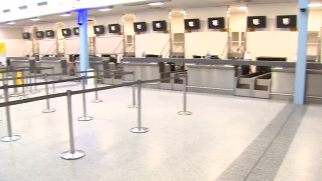 deserted check in desks at departures at southampton airport due to airline flybe going into administration - airport stock videos & royalty-free footage
