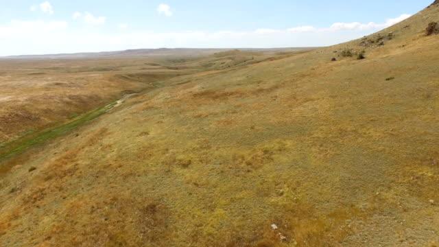Deserted hilly terrain, aerial video