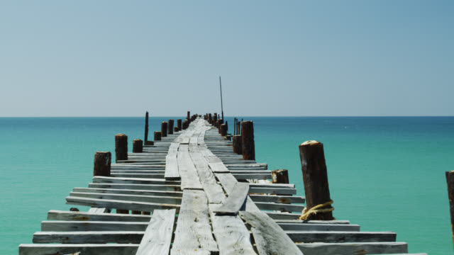 deserted jetty on beach in phang nga, phuket, thailand - jetty stock videos & royalty-free footage