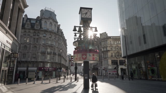 a deserted leicester square in central london in spring at the famous swiss clock - 20 seconds or greater stock videos & royalty-free footage
