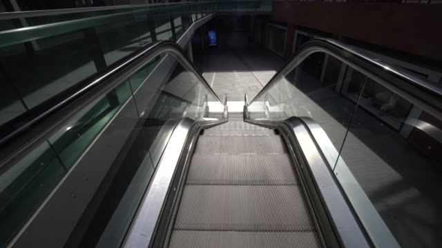 a deserted liverpool one shopping centre as the uk begins strict lockdown measures to combat the pandemic on march 24 2020 in liverpool england... - buying stock videos & royalty-free footage