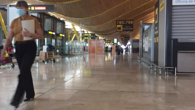 deserted madrid airport departures, due to coronavirus pandemic and quarantine restrictions imposed by uk government - reportage stock videos & royalty-free footage
