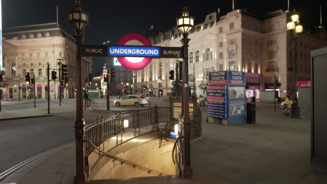 a deserted piccadilly circus london on a friday night in april 2020 - international landmark stock videos & royalty-free footage