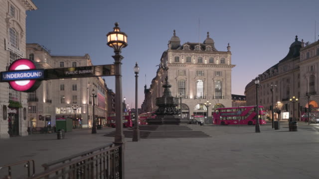 a deserted piccadilly circus london on a friday night in april 2020 - column stock videos & royalty-free footage