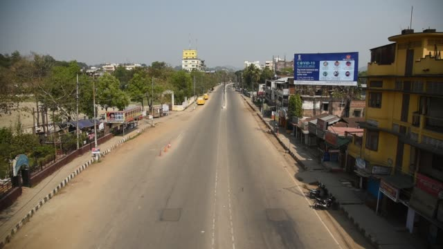 a deserted road of guwahati city after lockdown in the wake of covid-19 - india stock videos & royalty-free footage