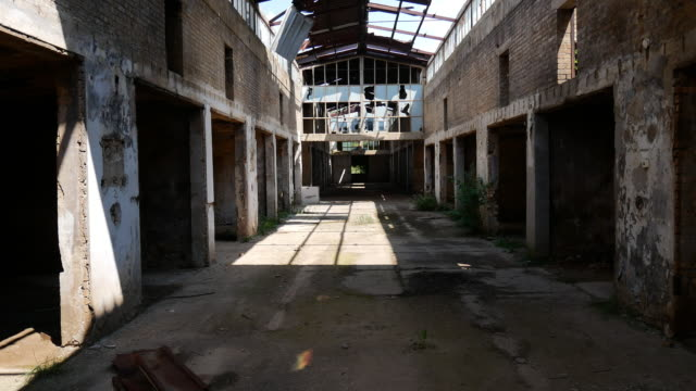 deserted ruins of old factory - broken windows and demolished interior - abandoned stock videos & royalty-free footage