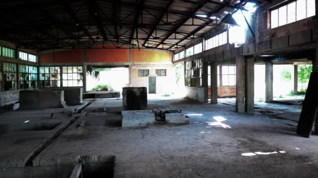 deserted ruins of old factory - broken windows and demolished interior - abbandonato video stock e b–roll