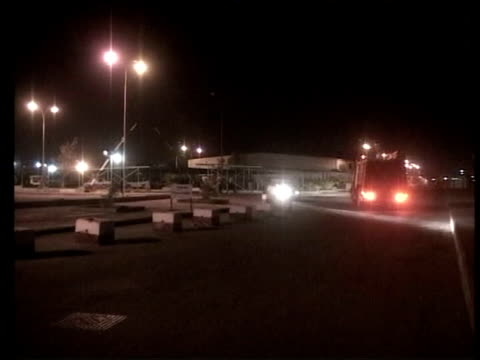 deserted street as gunfire heard sot ms shi'ite militia supporters of rebel cleric moqtada alsadr around pickup truck ms fire engine along street pan... - muqtada al sadr stock videos & royalty-free footage