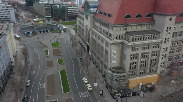 deserted streets at the famous kaufhaus des westens at kuhdamm in berlin where on normal days the streets are crowded on march 21 2020 in berlin... - viral infection stock videos & royalty-free footage