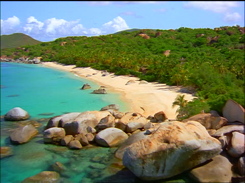 vidéos et rushes de aerial deserted tropical beach with palm trees / valley trunk bay, british virgin islands - 1998