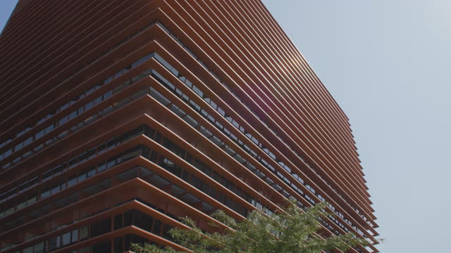 design orange building at barcelona dolly shot. cnmv spanish stock market offices at poblenou 22@ district - abstract stock videos & royalty-free footage