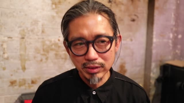 vídeos de stock, filmes e b-roll de designer akira isogawa speaks backstage ahead of the akira show at mercedesbenz fashion week resort 19 collections at carriageworks on may 17 2018 in... - andrew mathers
