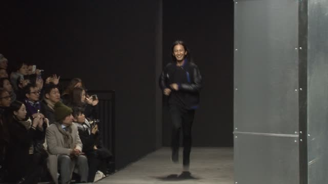 Designer Alexander Wang walks the runway during Alexander Wang MercedesBenz Fashion Week Fall 2014 at Brooklyn Navy Yard on February 8 2014 in...