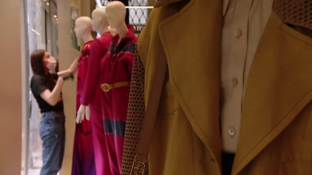 "designer clothes shop alberta ferretti in milan preparing to reopen after coronavirus lockdown - ""bbc news"" video stock e b–roll"