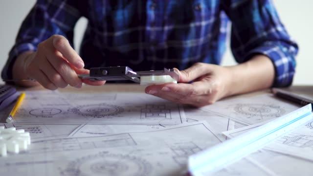designer engineer designs gear to make by 3d printing - vernier calliper stock videos & royalty-free footage