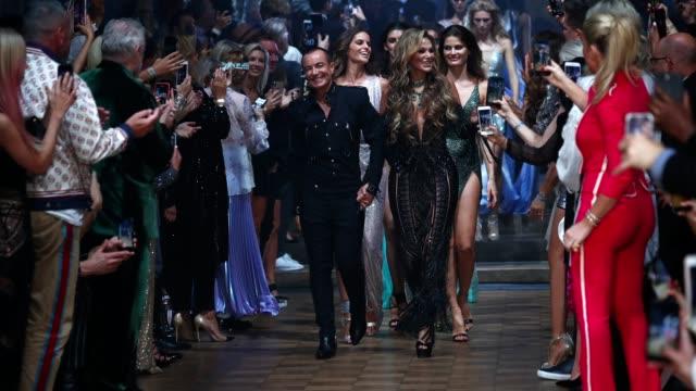 designer julien macdonald and gabriela gonzalez walk the runway during the finale at the julien macdonald show during london fashion week september... - fashion week stock videos & royalty-free footage