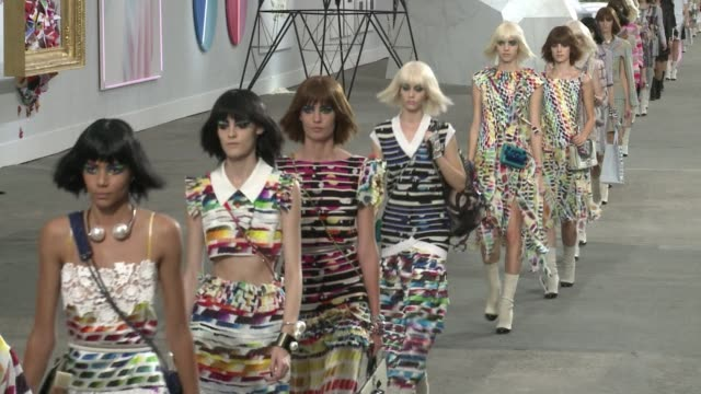 Designer Karl Lagerfeld has shwon off his new spring/summer 2014 collection for Chanel at Paris fashion week CLEAN Karl Lagerfeld unveils Chanel on...