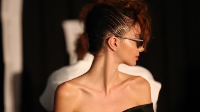 designer toni maticevski prepares backstage ahead of the mercedesbenz presents maticevski show at mercedesbenz fashion week resort 17 collections at... - back stage fashion week australia 2016 stock videos & royalty-free footage