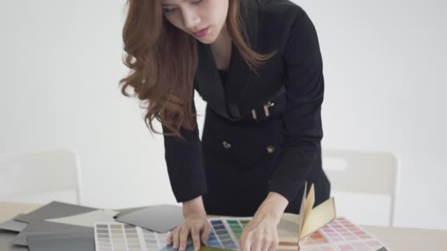 designer woman working on creative office - interior designer stock videos & royalty-free footage