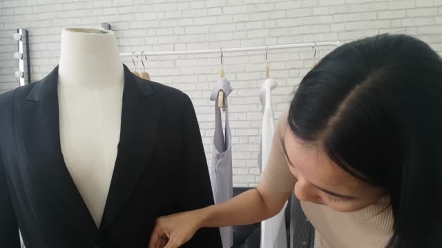 designer women measuring suit at her work place - instrument of measurement stock videos & royalty-free footage