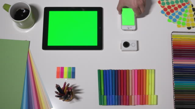 a designer working on a tablet - colour sample stock videos & royalty-free footage