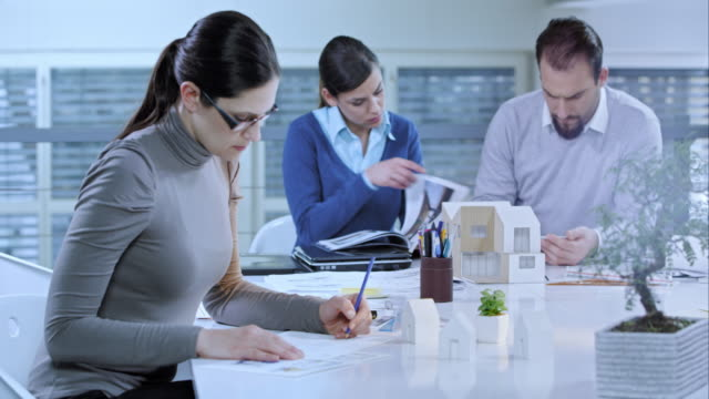 Designer working on new ideas in meeting room