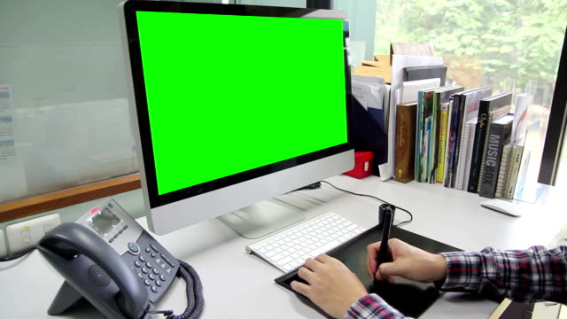 hd : designer working with 2 monitor green screen - digitized pen stock videos & royalty-free footage