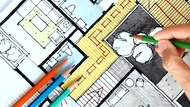 designer's hand working with home floor plan - colored pencil stock videos and b-roll footage