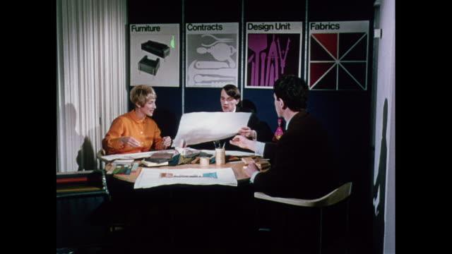 vídeos y material grabado en eventos de stock de montage designers reviewing interior design plans in london / united kingdom - 1960 1969